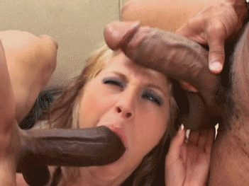 Putting two black cocks in her mouth